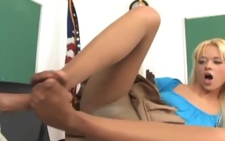hottie in ripped hose gives a dirty footjob