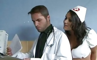 breasty brunette nurse in blac strap receives