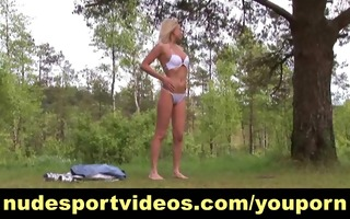 sexy blonde having undressed outdoor workout