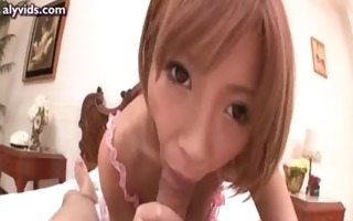 asian cutie in pink jerking and gives blow job