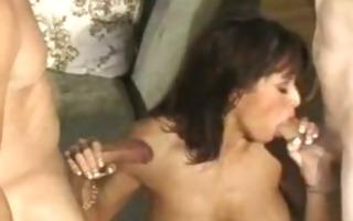 muscle mamma enjoying 2 cocks