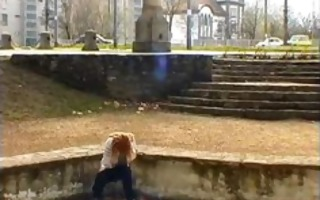 aged redhead peeing on the streets with people