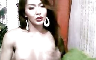 oriental tgirl plays with her pounder
