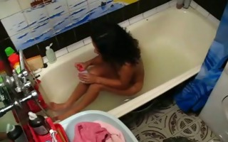 girl masturbates in her bathtub