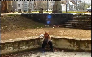 mature redhead peeing on the streets