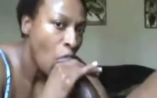 swarthy aged playgirl sucks large dark pecker