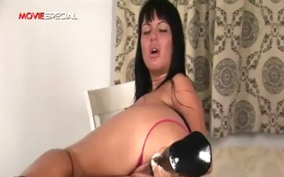 breasty slut working on a massive sex-toy