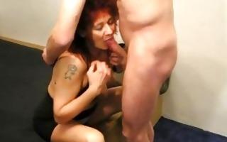 mature redhead non-professional wife sucks and