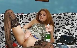 drunk redhead babe in dark nylons fingers her