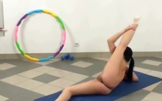 in nature gymnast exercises her hot body