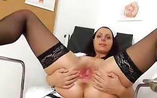 speculum in a taut madam medic pussy
