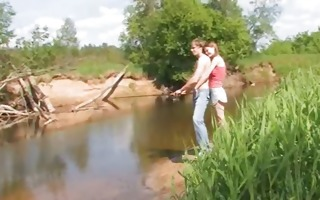 young couple coitus by the lake