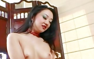 diminutive asian teases and masturbates in a
